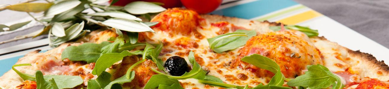 Dégustez nos délicieuses pizzas cuites au feu de bois !